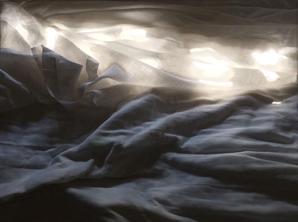 rumpled sheets with sunlight