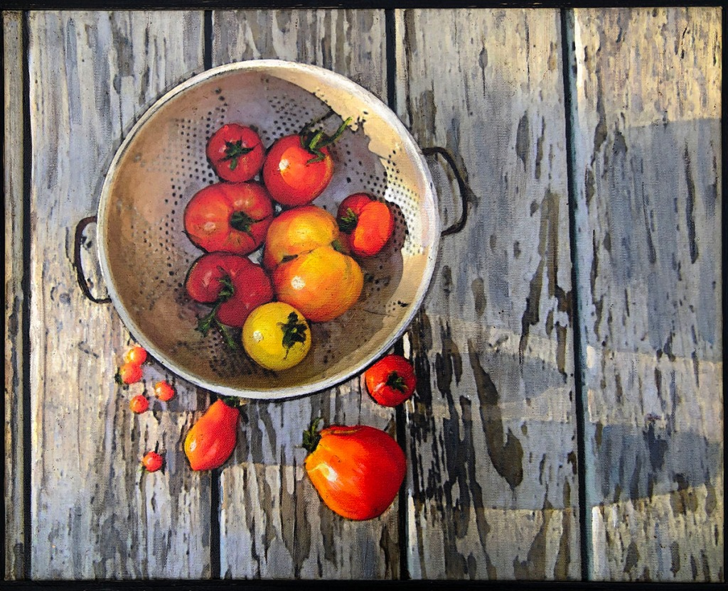 tomatoes in a colander on porch floor