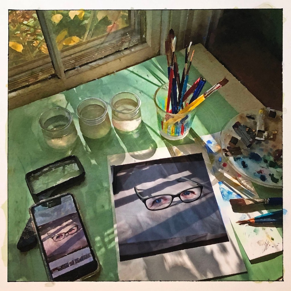 water color of eye painting on desk